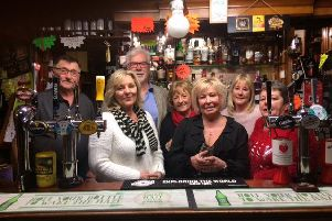 Cath Hadwin (second from the left) and Lynda Steward, with, left to right,  Woodies landlord Dave Carter and friends Norman Pickvance, Sue Brown, Helen Coxhill and  landlady Jane Carter