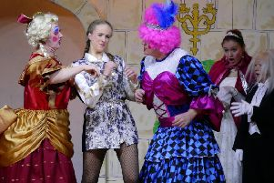 The Prince tries to keep Ugly sisters from bickering in Rothbury Pantomime Society's production of Cinderella. Picture by Duncan Elson