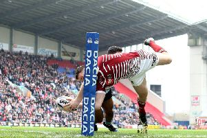 Joe Burgess scores a try against Cronulla in the WCC two years ago