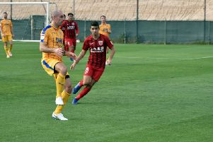 Darron Gibson in action in Dubai
