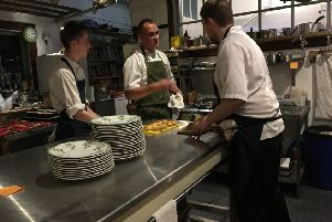 Andrew Wilkinson and sous chefs cooking at The Old Dairy in Ford.