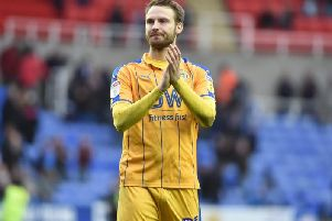 Nick Powell applauds the Latics fans at Reading