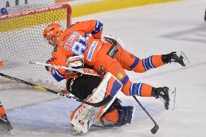COMING THROUGH: Ben O'Connor can't avoid colliding with Steelers' netminder Jackson Whistle during Saturday's 4-1 win at home to Fife Flyers. Picture: Dean Woolley.