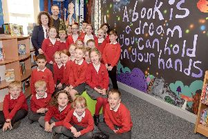 Head Tracey Beaty and artist Ian Edmondson join pupils at the official opening of the new library.