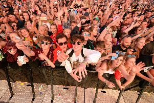 Festivalgoers at the Pyramid Stage at Glastonbury Festival, Worthy Farm in Somerset. The Killers and The Cure have joined Glastonbury Festival's line-up of headliners - while Janet Jackson is also on the bill.