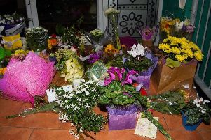 Flowers are placed on the front steps of the Wellington Masjid mosque in Kilbirnie in Wellington on March 15, 2019, after a shooting incident at two mosques in Christchurch. - Attacks on two Christchurch mosques left at least 49 dead on March 15, with one gunman -- identified as an Australian extremist -- apparently livestreaming the assault that triggered the lockdown of the New Zealand city. Photo: Getty Images.