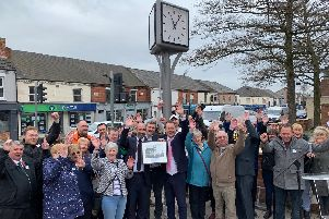 Residents and councillors celebrate the opening of the clock.