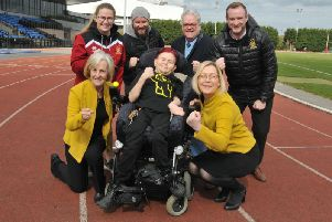 Matthew Unsworth at Robin Park Arena with supporters from Daffodils Dreams, Pianos, Pies and Pirouettes and Wigan Warriors Ladies
