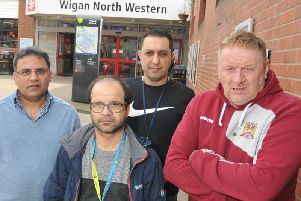 Taxi drivers, from left, Abrar Ahmed, Mike Goksuacik, Ramon Hossinjani and Ian Rogers, representative of Wigan North Western RMT (union of Rail, Maritime and Transport workers)