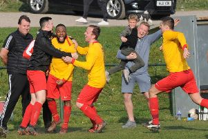 Dan Sheriffe, facing camera, celebrates his last-minute winner for Aberford in the 2-1 victory at Kippax. PIC: Steve Riding