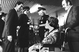 Prince Charles and Princess Diana chat to Stephen Hooton and his proud dad Jim as they arrive at Wigan North Western station en route to Skelmersdale in 1986