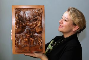 Hannah Phillip, director of Fairfax House with the Grinling Gibbons sculpture. Picture: Richard Doughty Photography