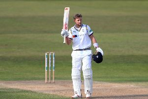 TOP MAN: Yorkshire's Joe Root celebrates reaching his century at Trent Bridge. Picture: Simon Cooper/PA