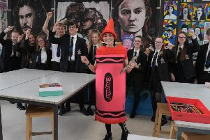 Belinda Neild gets encouragement from her pupils as she prepares for the London marathon dressed as a crayon