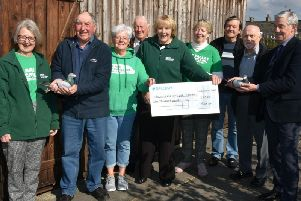 Ribble Valley Macmillan chairman Susan Fillary is pictured receiving the cheque from the organisers.