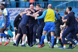 Paul Cook celebrates Wigan Athletic's win