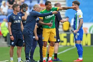 Preston boss Alex Neil gives instructions to Lukas Nmecha during the defeat at Wigan
