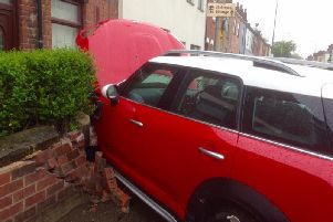 The car crashed through a garden wall