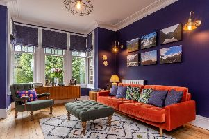 The separate sitting room painted in Dulux Oxford Blue. The sofa is from Habitat and sideboard from Oxfam