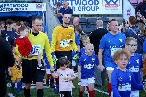 The teams head out onto the DW turf