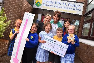 Pictured, back row from left, are Paula Sarjent and Emma Aspinall, from DoIt4Loui, with Castle Hill teacher Catherine Wilcock and pupils.