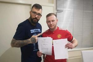 Coach Dean Brook and Mitch Turner with the contract