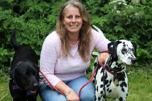Mum Emma Salt, of Clowne, who has won a major award in the skin care industry, pictured with her two dogs, Ned and Poppy.