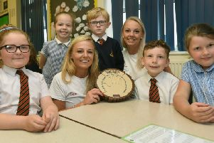 Gemma and Kate with pupils at Sacred Heart Catholic Primary School