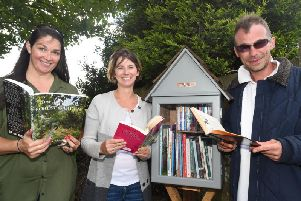 Samantha Anderson, Vikki Crompton and Corin Lomax, have created a free little library in the Ellen Higginbottom memorial garden
