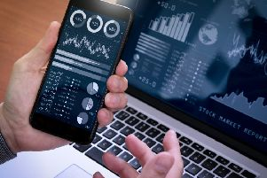 Investor analyzing stock market report and financial dashboard with business intelligence.