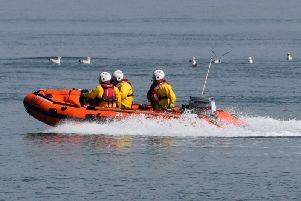 Morecambes volunteer lifeboat crew were tasked by HM Coastguard to assist in the rescue of a couple in their car after they became cut off by the tide in Shore Road, Silverdale