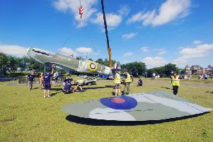 Fairhaven's memorial Spitfire is craned back into position after an eight month refurbishment