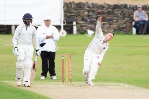Cleckheaton bowler Alex Midgley in action during the Bradford Premier League game at Lightcliffe last Saturday.