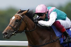 Enable, ridden by Frankie Dettori, winning the Coral Eclipse at Sandown Park earlier this month. (PHOTO BY: Alan Crowhurst/Getty Images).