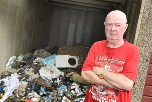 Tommy Boyle outside his garage