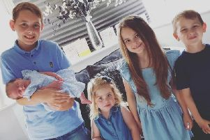 Ryley holding baby Dolly, Lillia, Tilly May and Bobby