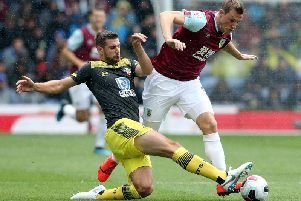 Burnley's Chris Wood is tackled by Southampton's Jan Bednarek