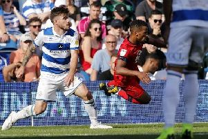 Nathan Byrne is sent flying at Loftus Road