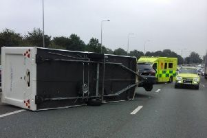 The overturned caravan on the M6