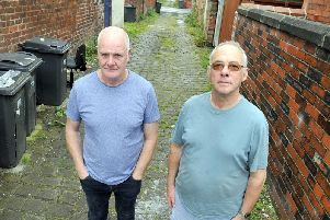 John Turner and David Yates, of Victoria Street in Lostock Hall, are fed up with their neighbourhood being used for fly-tipping.