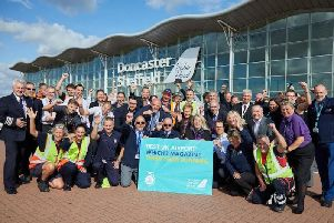 The Doncaster Sheffield Airport team celebrate being named Which? best UK airport