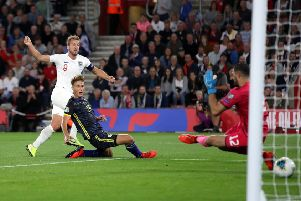 England's Harry Kane scores his side's second goal against Kosovo.
