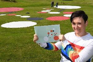 Artist Dani Gaines is creating a giant work of art, with the help of volunteers, on the grounds of the FootGolf course at Haigh Woodland Park, to celebrate the Tour of Britain passing by on Saturday