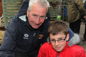 Much-loved George Herring with his grandson Josh, creating a club memorial garden in 2011