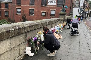 Floral tributes are left on a bridge in Radcliffe, Greater Manchester following the death of a baby boy