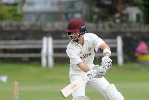 Brad Schmulian hit a sparkling century to help Woodlands book their place in the Yorkshire Premier Leagues play-off final after they secured a convincing win over Doncaster Town.