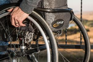 Person in wheelchair. Photo by Pixabay.