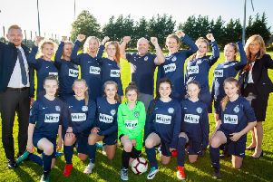 The Newton-le-Willows U14 girls team with their coach Ian Cross and Stewart Milne Homes representatives Ashton Foat and Angela Halliwell