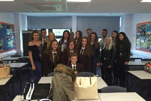 Miss Cole (far left) was described as Heckmondwike Grammar School Sixth Form headteacher Peter Roberts as 'a model student, extoling the values of working hard'