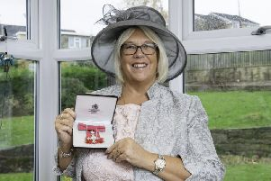 Mrs Evans, 61, of Liversedge, was awarded her MBE for services to Education